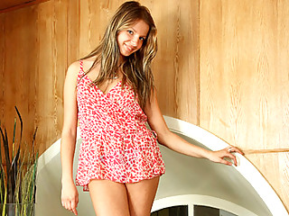 Sandy blonde haired teen happily exposes her supple breasts