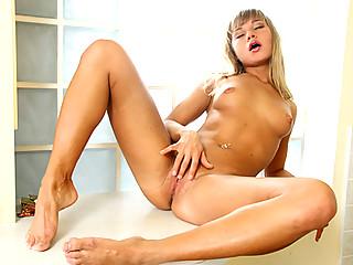 Tan blonde Nubile Halina rubs her swollen clit until she cums
