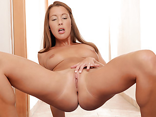 Seductive Nubile Elissa spreads her plump ass from behind