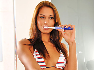 Nubile beauty Cipriana masturbates with her vibrating tooth brush